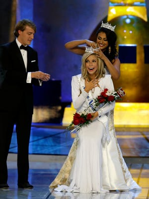 Miss America 2014 Nina Davuluri, top right, crowns Miss New York Kira Kazantsev as Miss America 2015 during the Miss America 2015 pageant, Sunday, Sept. 14, 2014, in Atlantic City, N.J.