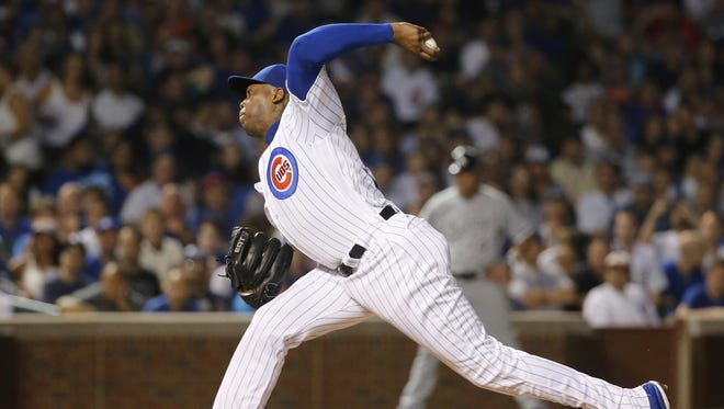 Chicago Cubs relief pitcher Aroldis Chapman delivers during the ninth inning of a baseball game and Cubs' 3-1 win over the Chicago White Sox Thursday, July 28, 2016, in Chicago. (AP Photo/Charles Rex Arbogast)