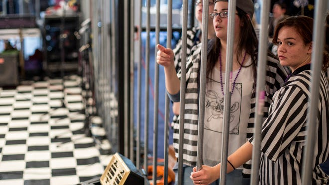 Victoria Montgomery, 14, right, and Aiyanna Rivera, 13, with Fort Gratiot Middle School, look to see how much money they have raised during the March of Dimes Jail and Bail Saturday, Feb. 4, 2017 at the Port Huron Masonic Center.