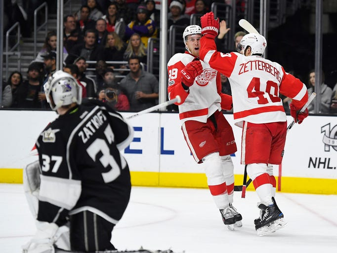 Red Wings forward Anthony Mantha, center, celebrates