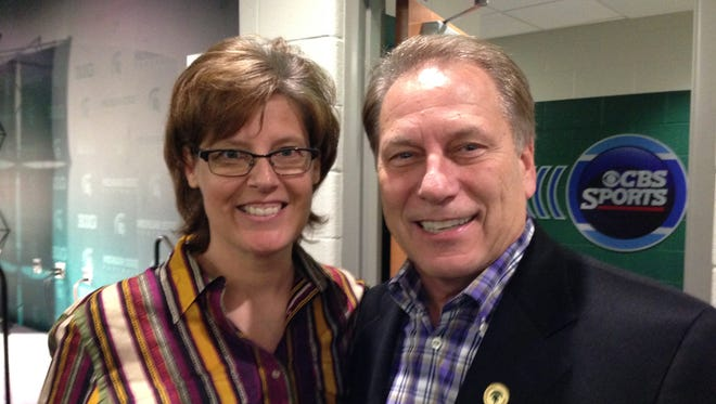 Livonia resident Aleta Sill is pictured with fellow Michigan Sports Hall of Fame inductee Tom Izzo during a November news conference.