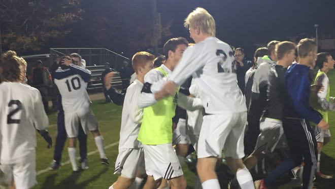 Harrison's soccer team celebrates its Class 2A North Semistate victory over Penn in penalty kicks.