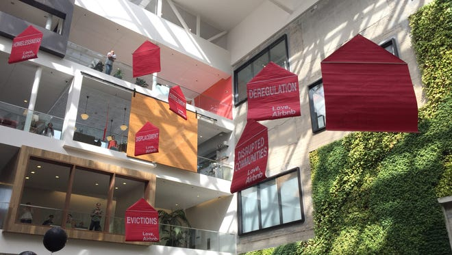 Banners released by protesters at Airbnb's headquarters in San Francisco on Monday, Nov. 3, 2015.