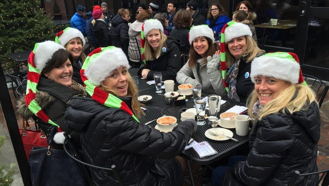 The Jingle Belles, a group of women from Charlotte and Shelburne who have known one another for years, enjoy a lunch of chili on the Farmhouse Tap and Grill patio Wednesday, Dec. 16, 2015, in Burlington during the annual COTS fundraiser Coolest Lunch. The women said this was their sixth consecutive year participating in the event.