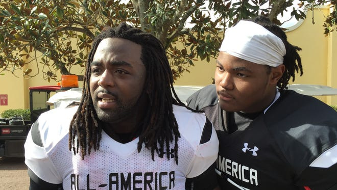 No. 1 recruiting prospect Rashan Gary, right, steps in as U-M signee Kareem Walker chats with reporters during Under Armour All-America practice Dec. 29, 2015.