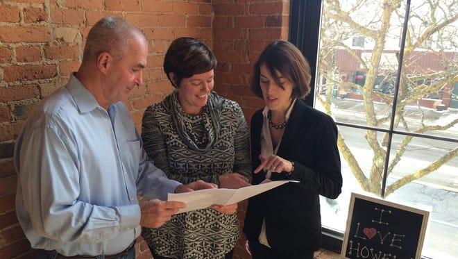 From left, Joe Parker, Courtney Tarara and Cathleen Edgerly look over design plans in the Heart of Howell building.