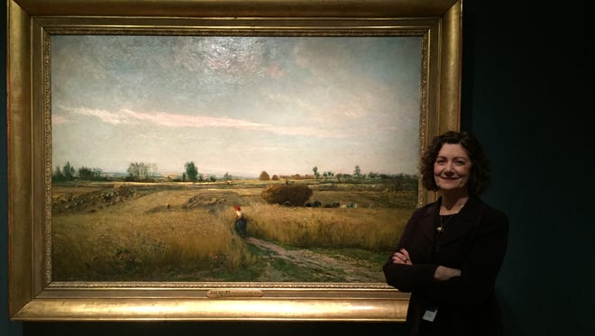Lynne Ambrosini at the Taft Museum of Art with Daubigny's The Harvest, 1851, Musée d'Orsay, Paris