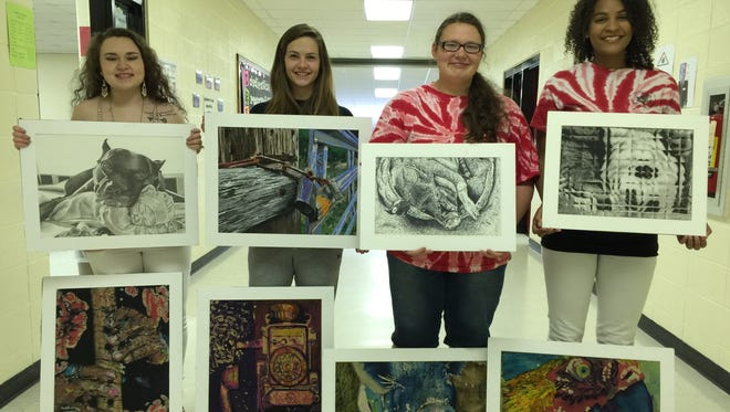 Alejandra Martinez, from left,  Ariona Pennington, Montana Greve and Lucy Gaskin, received awards at the Arkansas Young Artist competition recently.