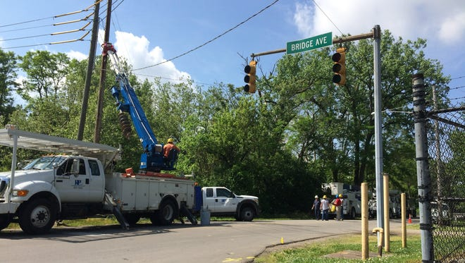 A Richmond Power & Light crew works to repair a pole that was taken down during an accident Sunday morning near Sim Hodgin Parkway and Bridge Avenue.