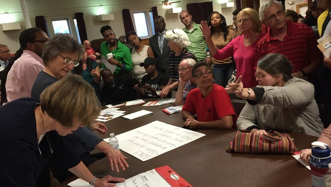 Participants share ideas at a Rochester-Monroe Anti-Poverty Initiative forum last July. The need for adult mentoring, which will be implemented this fall in three northeast neighborhoods, came from events such as this.