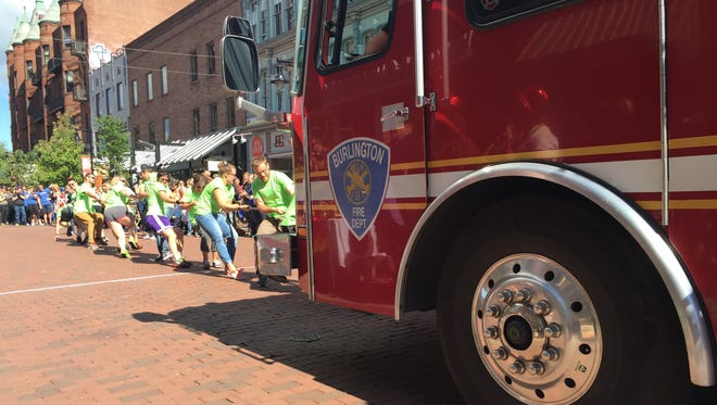The Dealer.com team gets the fire truck rolling in Saturday's Outright Vermont Fire Truck Pull fundraiser.