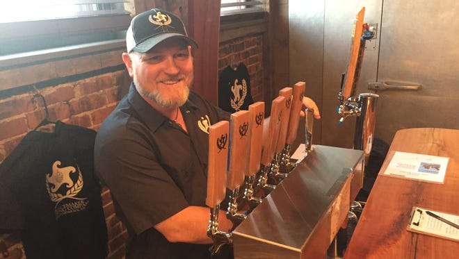 Todd Reardon, owner/brewer at Canandaigua's Peacemaker Brewing, pours a sample at his recently opened brewery.