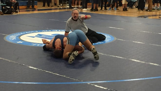 Ketcham's Isaac Matthews and John Jay's Derek White wrestle at the Section 1 dual meet tournament on Wednesday in Wiccopee.