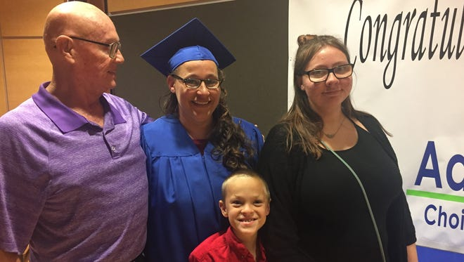 Katherine Park (center) celebrated receiving her High School Equivalency diploma with her son Kristopher, her daughter Kariann and her uncle Mark Durfee on Aug. 29, 2017.