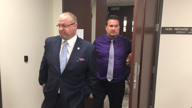 Fraser Mayor Joe Nichols, left, and Councilman Matt Hemelberg leave Macomb County Circuit Judge Richard Caretti's courtroom Sept. 13, 2017 after a hearing where they asked the judge to cancel a city council tribunal hearing where they could be removed from office.