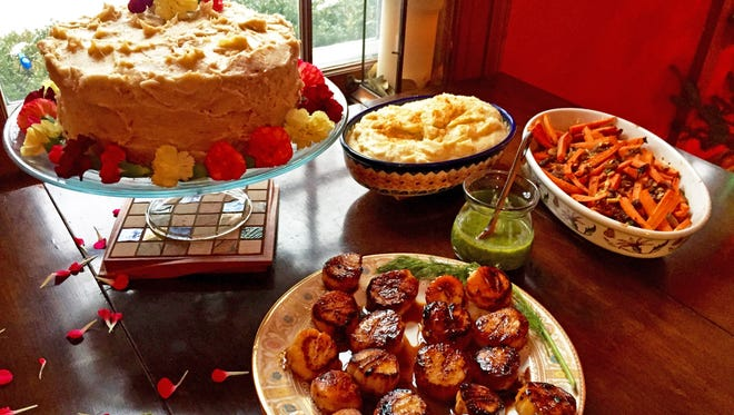 Caramel cake with edible flowers, scallops with chimichurri sauce, celery root-parsnip puree and roasted spiced carrots all add up to a trendy meal for 2018.