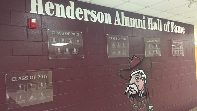 The Henderson Alumni Hall of Fame wall in the main hallway of Henderson County High school.