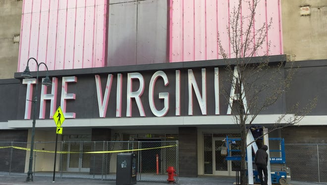 Workers install a new sign on the Virginian on South Virginia Street in Reno on Friday, March 30, 2018. The original facade was disassembled in 2016, when it opened as renovated apartments for University of Nevada, Reno foreign exchange students.