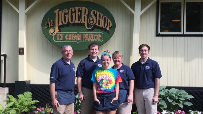 Paul Seyfert (left) with his wife, Beth, and children, Ben, Luke and Hailey have a combined 35 years experience working at The Jigger Shop.