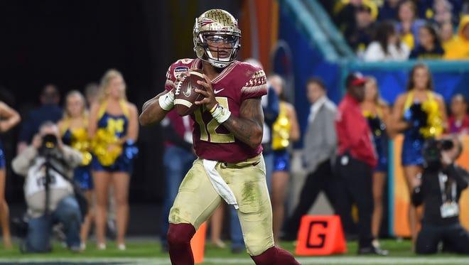 Florida State quarterback Deondre Francois looks to throw against Michigan during the Orange Bowl.