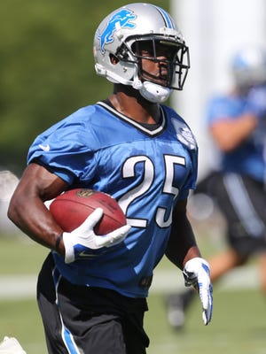 Detroit Lions running back Theo Riddick goes through drills at training camp on Aug. 4, 2015, at the practice facility in Allen Park.
