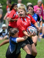 Lexi Engelhardt of Wisconsin Red passes the ball during a match at the Lakefront 7s Rugby Tournament in 2017. This year's tournament is Saturday in Veterans Park.