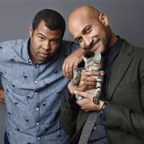 Jordan Peele, left, and Keegan- Michael Kay with a tabby kitten.