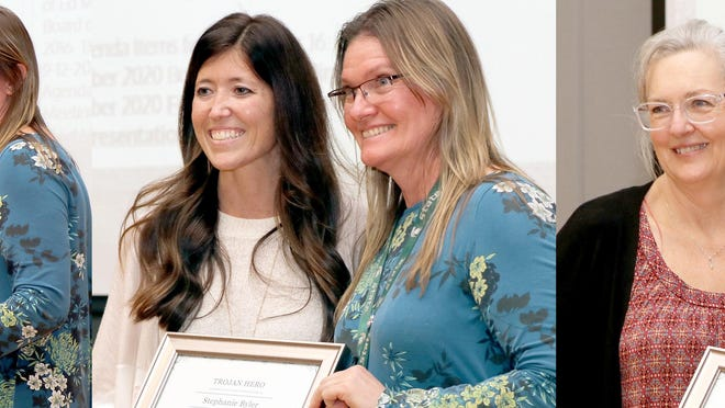 """Andrea Littlefield, Stephanie Byler and Alison Idriss were presented with certificates Monday by assistant superintendent Nicole Airgood, designating them """"Trojan Heroes."""""""