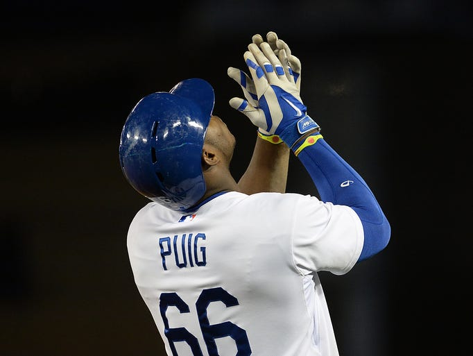 Puig looks to the sky after a single against the Braves