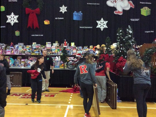 On the stage of the College Avenue Gym, organizers collected and displayed the more than 10,000 toys collected from the Big Chill runners.
