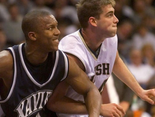 Xavier's David West (30) and Notre Dame's David Graves battle for position during their NIT second-round game Monday March 20 2000 in South Bend Ind.