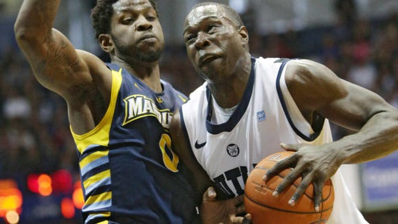 Saturday January 18th, 2014, Butler Bulldogs forward Khyle Marshall (23) is fouled by Marquette's (0) Jamil Wilson. The Butler Bulldogs VS The Marquette Golden Eagles at Hinkle Fieldhouse.
