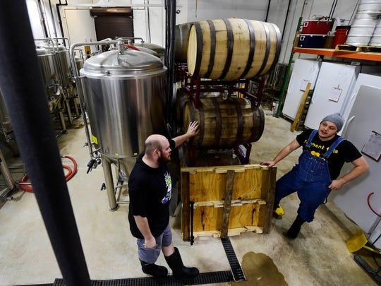 Collusion co-owner and head brewer Jared Barnes, left,