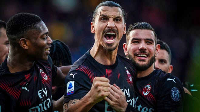 Milan's Zlatan Ibrahimovic celebrates with teammates after scoring his side's second goal during an Italian Serie A soccer match between Cagliari and Milan in Cagliari, Saturday, Jan. 11, 2020.