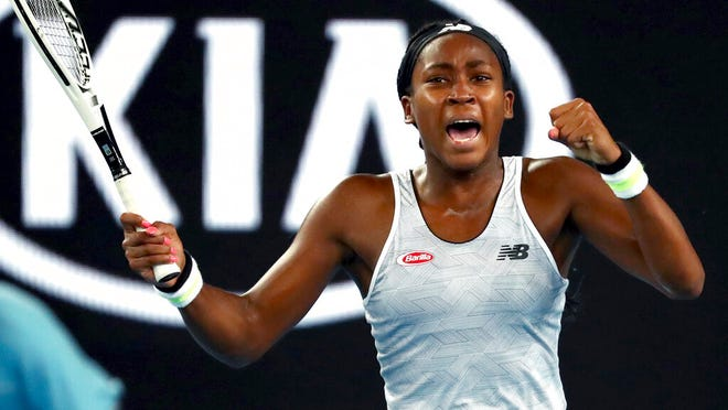 "United States' Cori ""Coco"" Gauff reacts during her first round singles match against compatriot Venus Williams at the Australian Open tennis championship in Melbourne, Australia, Monday, Jan. 20, 2020."
