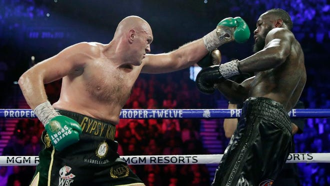 From Feb. 22, 2020, Tyson Fury, left, of England, fights Deontay Wilder during a WBC heavyweight championship boxing match in Las Vegas. An all-British world heavyweight title showdown between Anthony Joshua and Tyson Fury in 2021 is a step closer. Fury said Wednesday, June 10, 2020, that an agreement has been reached with Joshua's camp on a two-fight deal between the current holders of the heavyweight belts.