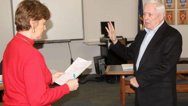 Donna Meier Pfeifer, Pratt Community College Clerk of the Board of Trustees, reads the oath as new trustee Ed Barrett is sworn in at the Jan. 13 board meeting.