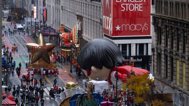 Floats that are part of the modified Macy's Thanksgiving Day Parade are seen from the Empire State Building in New York, Thursday, Nov. 26, 2020. Due to the pandemic, no crowds of onlookers were allowed to attend the annual parade.