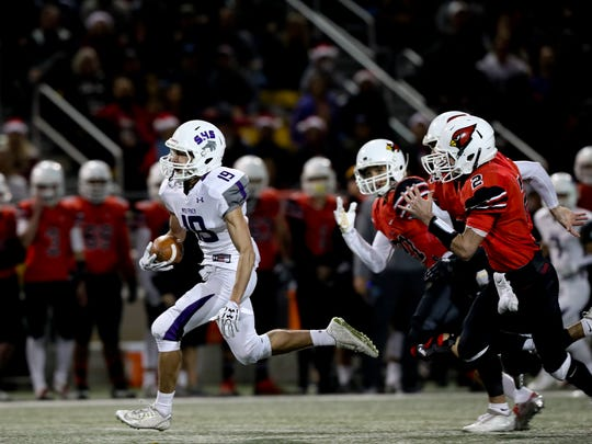 Shasta's Kenyon Riley takes the ball in for a score Saturday during the Wolves 41-6 loss to Bishop Diego.