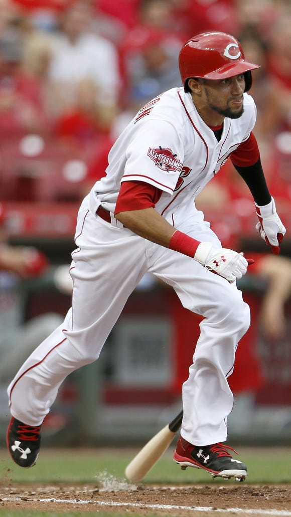 Reds center fielder Billy Hamilton takes off for first
