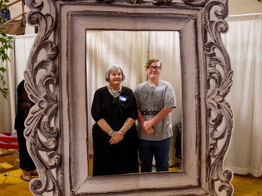 Nancy Hawkins and her grandson, Gauge Goodson, 15, a freshman at Henderson County High School, have their portrait made at the senior citizen prom in the school's gymnasium Monday morning.