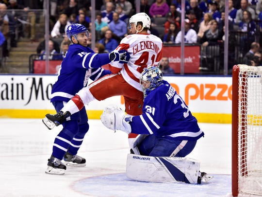Toronto Maple Leafs center Tomas Plekanec pushes Detroit Red Wings right wing Luke Glendening into goaltender Frederik Andersen during the first period Saturday, March 24, 2018 in Toronto.