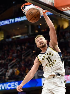 Indiana Pacers center Domantas Sabonis (11) dunks in the first quarter against the Cleveland Cavaliers at Quicken Loans Arena.