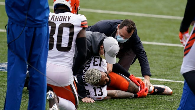 The Browns' Odell Beckham Jr. (13) is examined during the first half of Sunday's game against the Bengals. He will miss the rest of the season after tearing a knee ligament during that game.