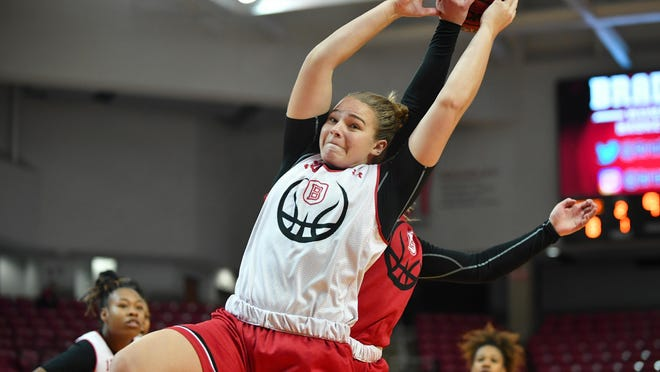 Bradley's Emily Marsh tries to pull down a rebound during the Red-White Scrimmage at Renaissance Coliseum.