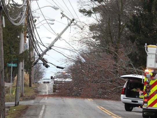 File Photo: A pole snapped after a tree that had taken down another power line pulled on the lines. A portion of Edgewood Drive in Brighton was closed temporarily during recent wind storm.
