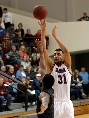 Bellarmine University's Yasin Kolo (31) fights to get his shot off under pressure from Lincoln Memorial University's Curtis Webb (5) during the second half of play at Bellarmine University in Louisville, Kentucky.       January 2, 2016
