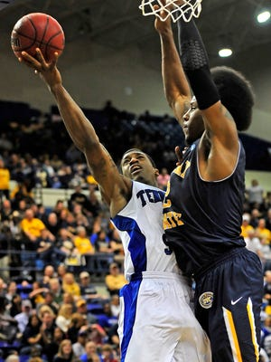 Tennessee State's Patrick Miller, left, is fouled by Murray State's Ed Daniel during the second half at Gentry Center in Nashville, Tenn.
