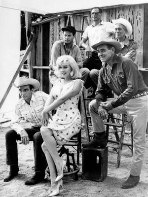"Eli Wallach is at the left in the back row of this photo showing the cast of ""The Misfits,"" which was filmed around Dayton and Reno in 1960. Wallach died Tuesday, June 24, 2014, at 98. Also in the photo are: Front row, left to right: Montgomery Clift, Marilyn Monroe, Clark Gable. Back row, left to right: Eli Wallach, playwright Arthur Miller and director John Huston."