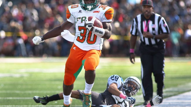 Running back Gerald Hears steps out of bound after a 10-yard runs against Howard on Saturday.